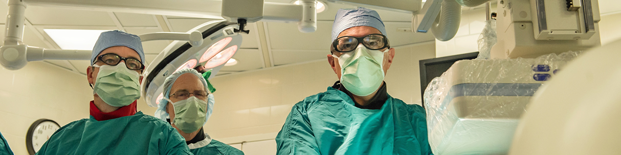 Three U-M Frankel Cardiovascular Center surgeons during surgery