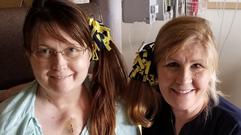 Two adult female U-M heart patients with maize and blue ribbons in their hair