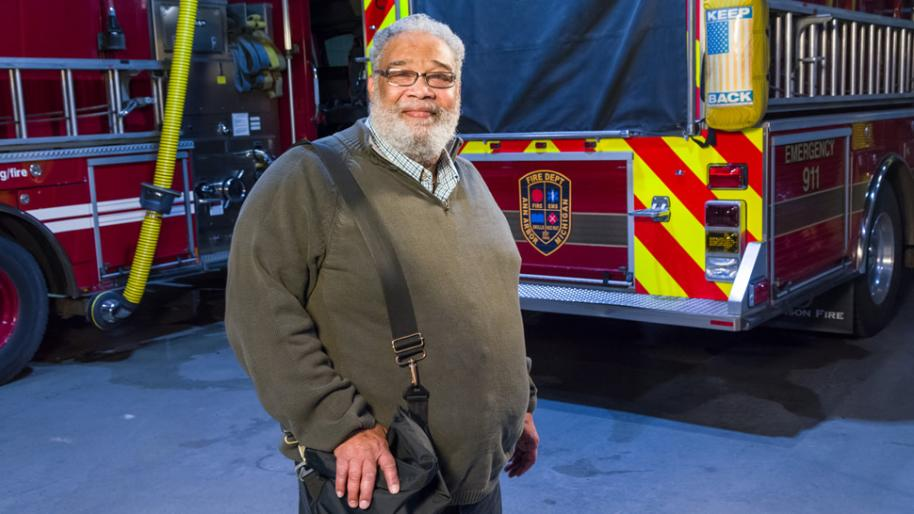 LVAD patient Furman Dillard standing in front of fire trucks