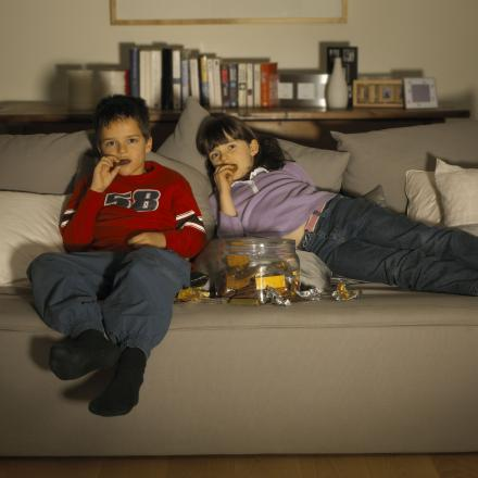 Children snacking during TV time
