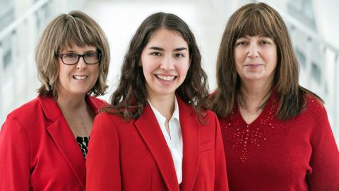 Three women dressed in red