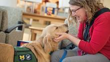 Golden retriever service dog with female chaplain